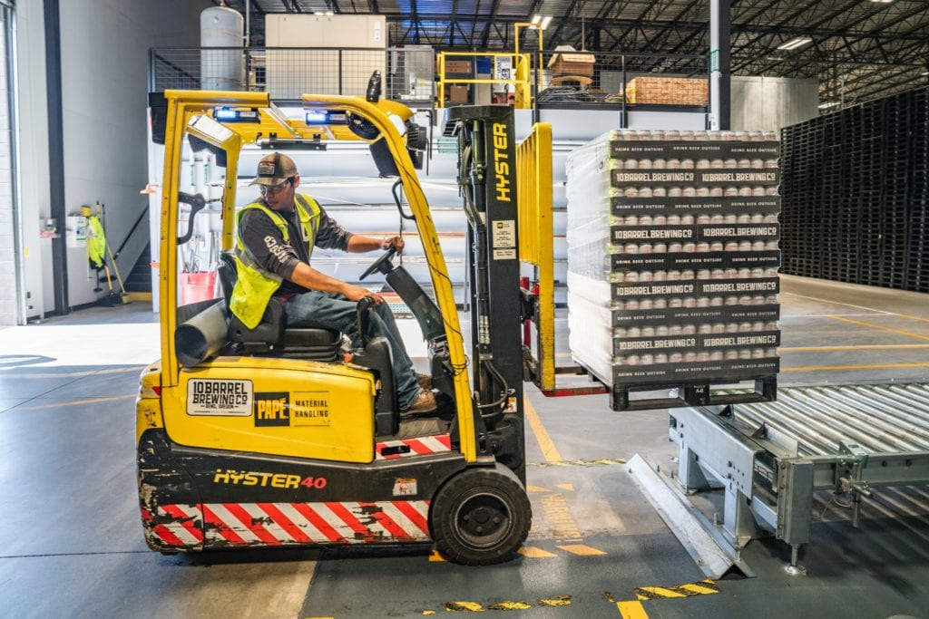 warehouse employee using a forklift